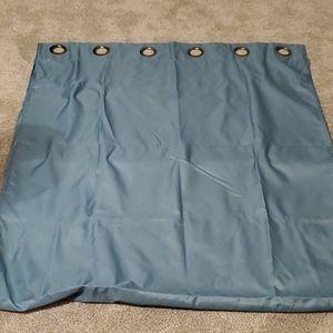 Two teal/aqua curtain panels